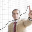 Businessman Presenting Financial growth curve — Stock Photo
