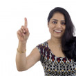 "Indian Woman pointing finger up showing ""ONE"" or ""WAIT A MINUTE"". — Stock Photo"