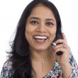 Happy Indian woman talking on a telephone. — Stock Photo