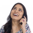 Happy Indian woman talking on a telephone.  — Stockfoto