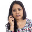 Concerned Indian woman talking on a telephone. — Foto de Stock