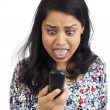 Indian Woman Annoyed and screaming at the phone. — Stock Photo