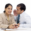 Office Gossip : Indian business Colleagues telling a secret or Spreading Rumour. Isolated on white. — Stock Photo