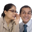 Office Gossip : Indian business Colleagues telling a secret or Spreading Rumour. Isolated on white. — Stock Photo #32942385