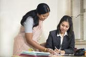 Indian Businesswoman explaining things to her subordinate. — Stock Photo