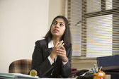 Thinking Indian Business woman — Stock Photo