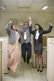 Business group jumping and celebrating — Stock Photo