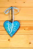 Turquoise heart on wooden wall — Stock Photo