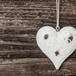 Old heart on wooden board — Stock Photo