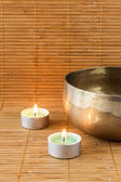 Singing bowle with bamboo background — Stock Photo
