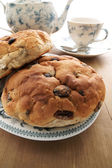 Toasted Teacakes a traditional British cake of raisin, sultanas and spices in a bun — Stock Photo