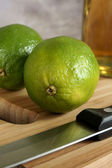 Fresh tangy green limes — Stock Photo
