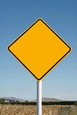 Blank yellow diamond road sign — Stock Photo