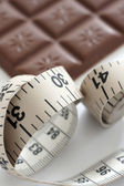 Tape measure and chocolate bar — Stock Photo