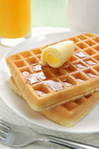 Waffles and maple syrup — Stock Photo