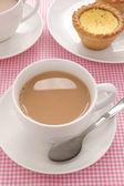 Tea with milk — Stock Photo