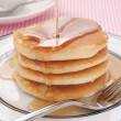 Stock Photo: Pancakes and maple syrup