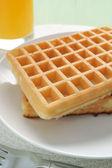Waffles and juice — Stock Photo