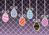 Hanging easter eggs — Stock Vector
