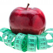 Red apple and tape measure. — Stock Photo