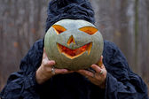 Stranger has pumpkin instead of his head — Stock Photo