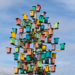 Сolorful birdhouses on background of blue sky — Stock Photo #35653683