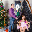 Stock Photo: Family before Christmas fireplace