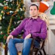 Portrait of a man in New Year's interior — Stock Photo