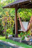 Garden house, hammock and chair — Stock Photo