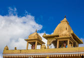 Indian temple's roof on blue sky background — Stock Photo