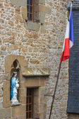 Madonna statue and French flag — Stock Photo