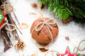 Christmas cake with snow and decorations — Stock Photo