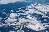 Snow covered mountains and clouds, the top view — Stok fotoğraf
