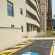 Handicapped parking space in new building — Stock Photo