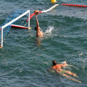 Water polo goalkeeper in action — ストック写真