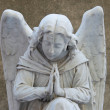Angel on tombstone on old cemetery — Stock Photo #31560937