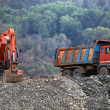 Trucks and bulldozers — Stock Photo