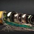 Fly fishing reel and feathers — Stock Photo
