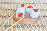 Sushi with salmon, caviar(mayonnaise) and a cucumber. — Stock Photo