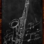 Saxophone drawing sketching on blackboard — Stock Photo #33466377