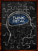 Think Detail Puzzle - On blackboard — Foto Stock