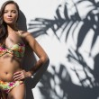 Relaxed gorgeous woman in flowery bikini posing — Stock Photo