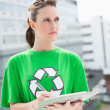 Stock Photo: Thoughtful activist holding clipboard