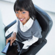 High angle view of smiling pretty businesswoman holding tablet — Stock Photo #31549781