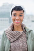 Content young model in winter clothes posing and looking at camera — Stock Photo