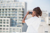Volunteer woman using binoculars — Stock Photo