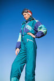 Woman in ski suit with one hand on hip — Stock Photo