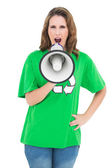 Environmental activist holding and shouting on megaphone — Stock Photo