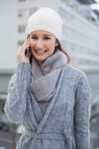 Cheerful gorgeous woman wearing winter clothes having a call — Stock Photo