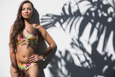 Relaxed gorgeous woman in flowery bikini posing — ストック写真